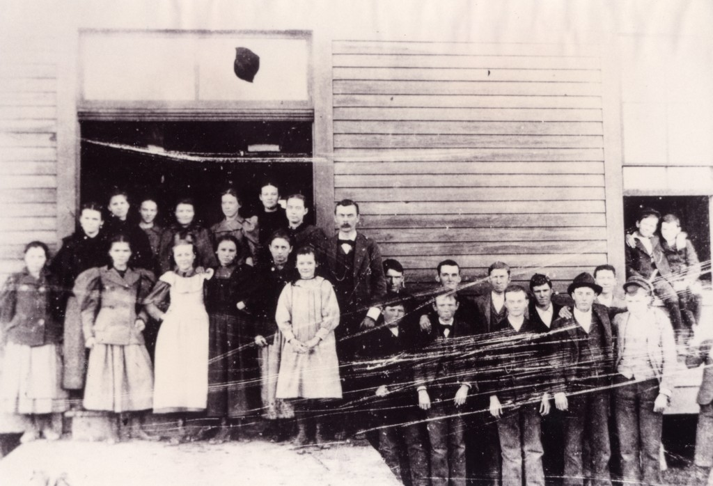 Forney public school after consolidation, 1895-1896. This shows classroom #1 with S.J. Lewis, principal and teacher.